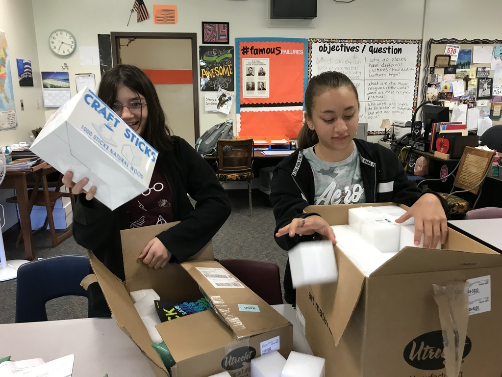 students opening supplies