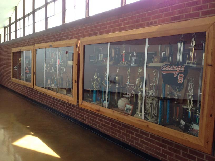 Picture of trophy case in gym lobby